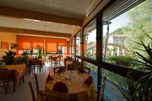 A restaurant or other place to eat at Logis Des Rives De L'Arzon
