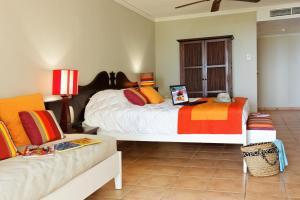 Un ou plusieurs lits dans un hébergement de l'établissement Résidence Pierre & Vacances Premium Les Tamarins