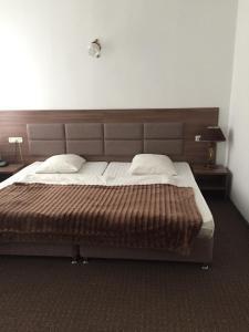 Кровать или кровати в номере Престиж Отель