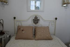 A bed or beds in a room at Casa Do Sobral