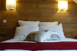 Un ou plusieurs lits dans un hébergement de l'établissement Ferme Boisquillon