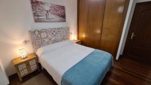 Cama o camas de una habitación en Apartamento Capricho de Muxía