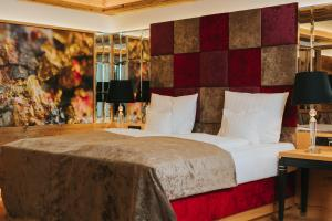 A bed or beds in a room at Ortner's Resort