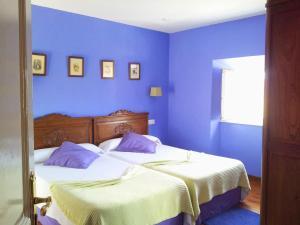 A bed or beds in a room at Casona Selgas de Cudillero