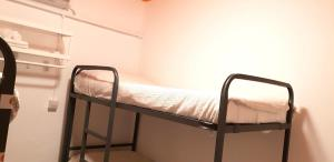 A bunk bed or bunk beds in a room at Arc House San Lorenzo