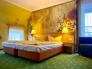 Ein Bett oder Betten in einem Zimmer der Unterkunft Querfurter Hof