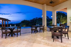 A restaurant or other place to eat at Villa Buena Onda Luxury Home Rental