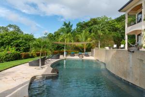 The swimming pool at or near Villa Buena Onda Luxury Home Rental
