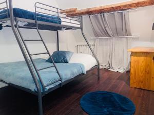 Un ou plusieurs lits superposés dans un hébergement de l'établissement Théâtre Hôtel Chambéry