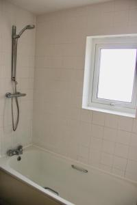 A bathroom at Luxes Suite