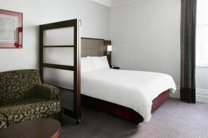 A bed or beds in a room at Club Quarters Hotel, Trafalgar Square