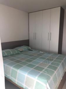 A bed or beds in a room at Brisa de Carapibus