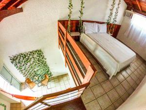 Cama ou camas em um quarto em Pousada Blessed Maresias