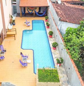 Uma vista da piscina em Pousada Blessed Maresias ou nos arredores