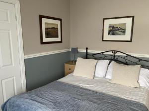 A bed or beds in a room at Gazelle Hotel