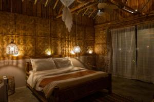 A bed or beds in a room at Amihan Beach Cabanas