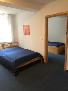 Ein Bett oder Betten in einem Zimmer der Unterkunft VITA Ferienresidenz