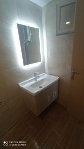 A bathroom at Zeus Throne Suites