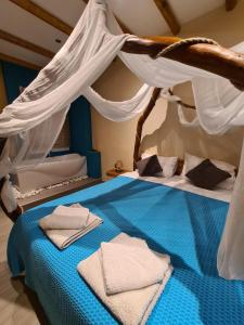 A bed or beds in a room at ThessPalace
