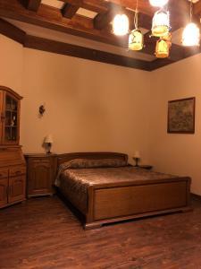 Кровать или кровати в номере Усадьба Ильинская