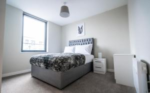 A bed or beds in a room at Dream Apartments Manchester
