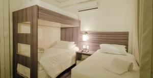 Cama ou camas em um quarto em Umbu Hotel Porto Alegre Centro Histórico