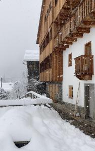 Tabià Alleghe vista lago, monte Civetta Dolomiti during the winter
