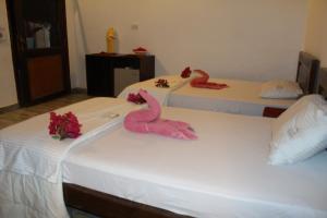Ліжко або ліжка в номері Sunshine Divers Club - Il Porto