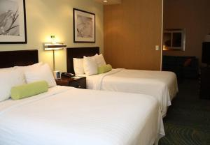 A bed or beds in a room at SpringHill Suites Morgantown