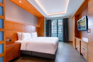 A bed or beds in a room at Resorts World Sentosa - Hotel Michael (SG Clean)