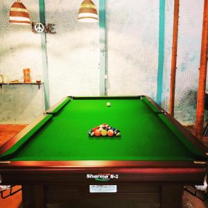 A pool table at Red Door Hostel