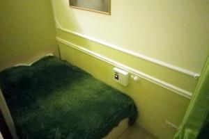 Кровать или кровати в номере Старый город