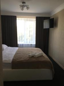 A bed or beds in a room at Elegia