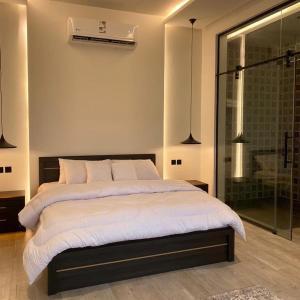 Cama ou camas em um quarto em شاليه تورو