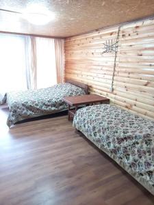 Кровать или кровати в номере Baza otdykha Rechnoy Breez
