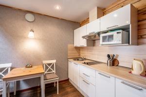 Кухня или мини-кухня в Литературный отель Арина Р