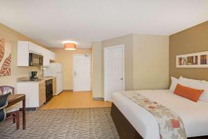 A bed or beds in a room at MainStay Suites Orlando Altamonte Springs