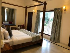 A bed or beds in a room at Hotel RAJBAGH Palace