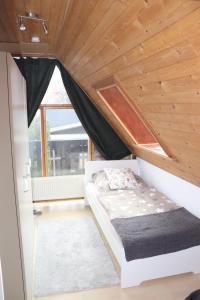 Ein Bett oder Betten in einem Zimmer der Unterkunft Ferienhaus Geli