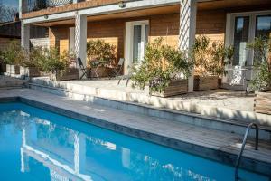 The swimming pool at or near Escale villa
