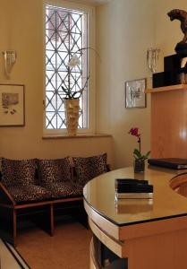Ein Sitzbereich in der Unterkunft Hotel Gregoriana