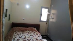 A bed or beds in a room at Residence H