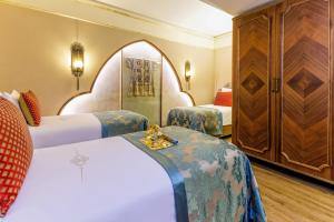 A bed or beds in a room at Romance Istanbul Hotel Boutique Class