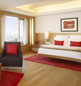 A bed or beds in a room at Trident Nariman Point