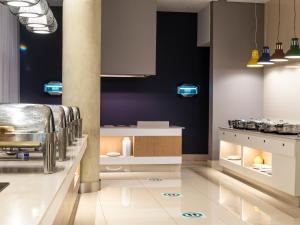 A kitchen or kitchenette at aha Gateway Hotel Umhlanga