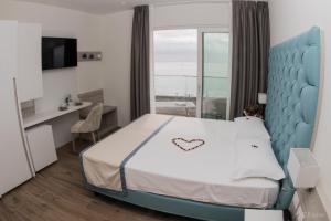 Postel nebo postele na pokoji v ubytování Hotel Ariston