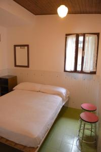 A bed or beds in a room at Camping Alpino - Nature Village