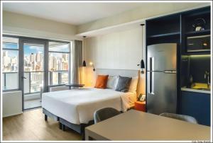 A bed or beds in a room at Aparthotel Adagio Sao Paulo Barra Funda