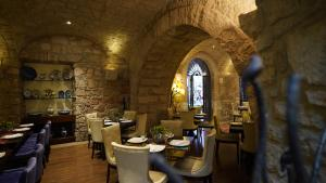 A restaurant or other place to eat at Hotel De La Soledad