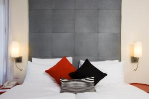 A bed or beds in a room at Harmony Hotel - an Atlas Boutique Hotel